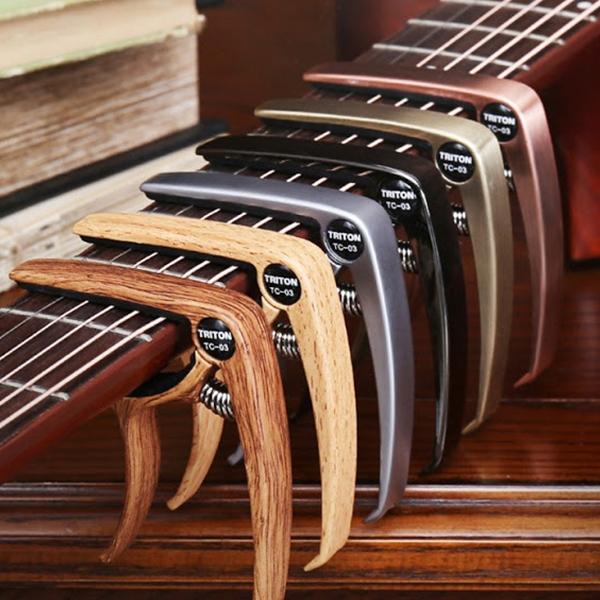 Capo guitar Biên Hòa TRITON